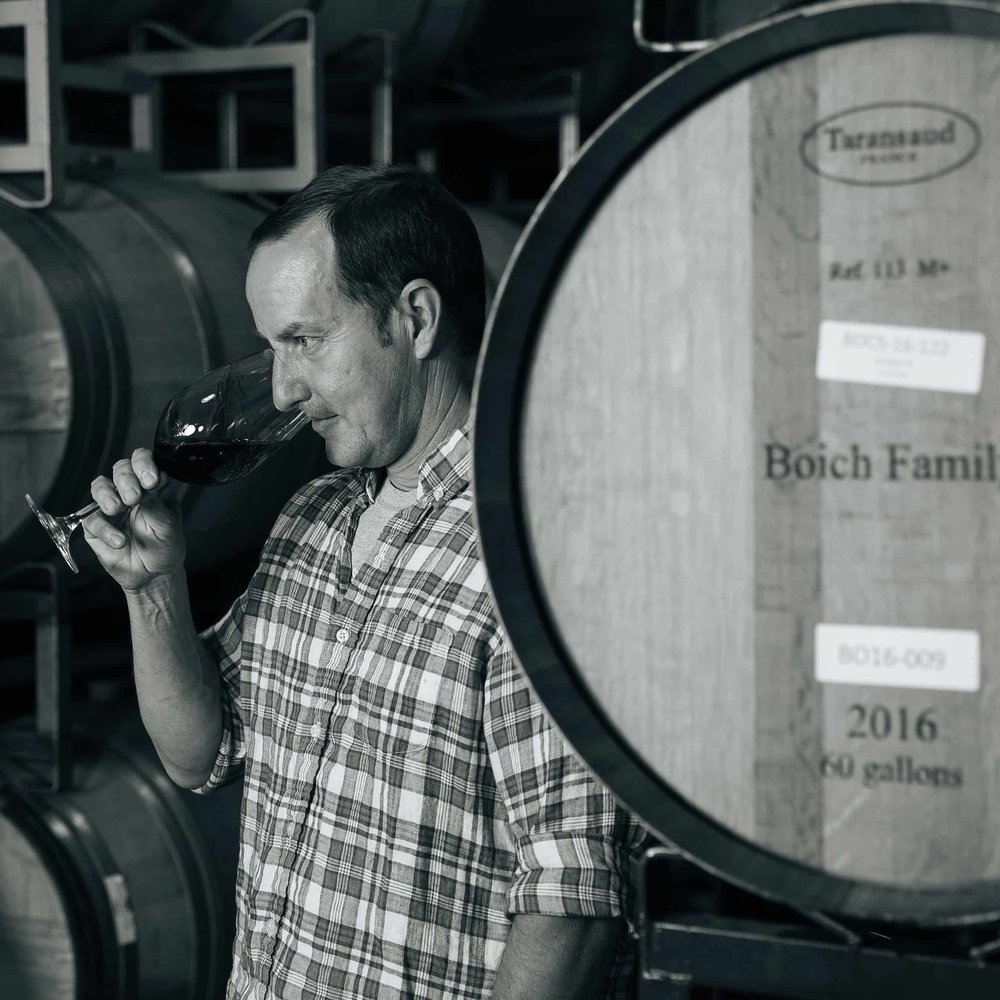 Jeff Ames Tasting Wine Next To Barrel